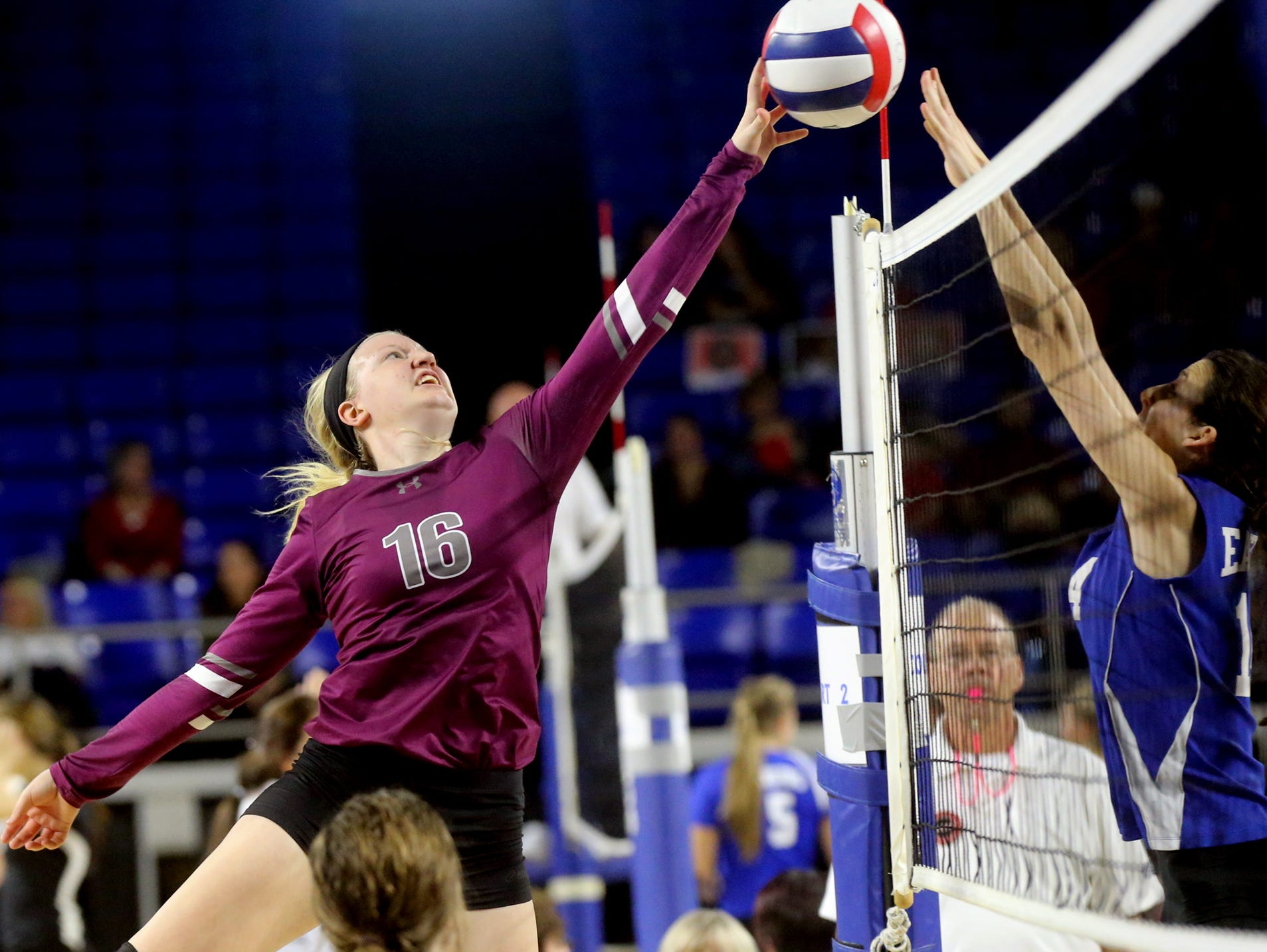 Eagleville's Kristin Barnes (16) matches off with Summertown's Madison Dinwiddie (14) during the losers bracket game of the TSSAA Class A state volleyball tournament, on Thursday, Oct. 22, 2015, at MTSU.