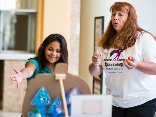Laura Quick (right), of Mentors 2 Heroes, helps Samantha