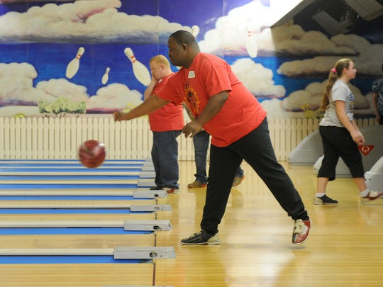 In this file photo, athletes bowl in the Special Olympics Area 9 event at Village Bowl.