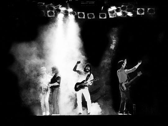 Alabama members Mark Herndon, left, Jeff Cook, Randy Owen and Teddy Gentry perform before 10,000 fans at Middle Tennessee State University's Murphy Center on April 19, 1986.