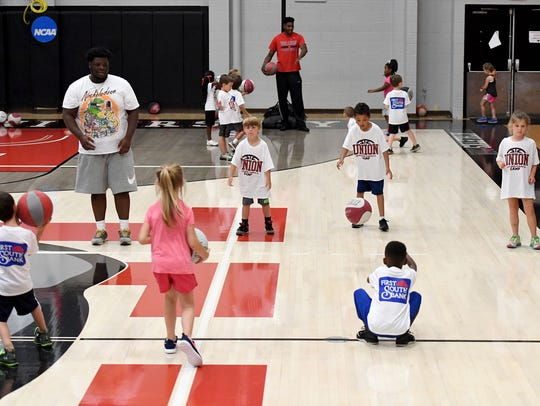 Campers learn how to bounce pass to each other during