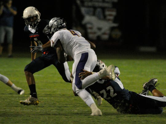 Tulare Western Ira Porchia pulls down a Fresno runner