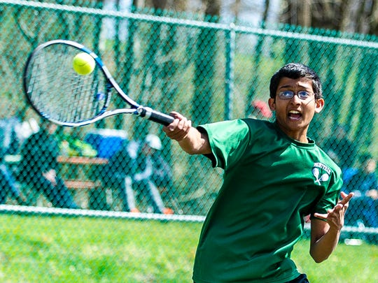 Mihir Paranjape of Montville competes in a Morris County Tournament first doubles semifinal at CCM in Randolph, April 29, 2018.