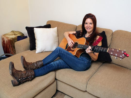 Kelly Flint, a former singer of DaveÕs True Story, a jazz/lounge band, is pictured at her apartment in Scarsdale, Oct. 7, 2015.