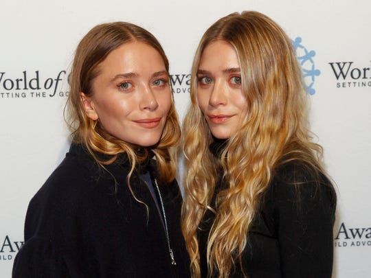 Mary-Kate Olsen, left, and Ashley Olsen attend the