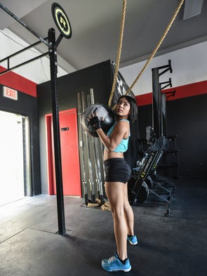 Keomi Pangelinan demonstrates a medicine ball throw