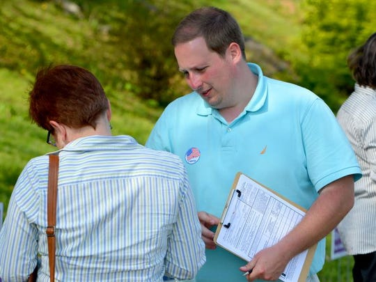 Will Hammer seeks signatures outside the Ward 3 polling place in Staunton in his quest for the required 1,000 signatures needed to get his name on the ballot as a Libertarian candidate for U.S. Congress 6th District in Virginia on Tuesday, May 6, 2014.