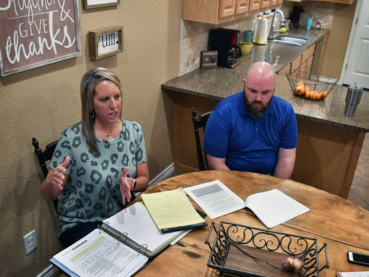 Chelsea and Tim Putney have kept a large binder full of paperwork, treatment requests, insurance denials, doctors opinions and treatments since Tim sustained a back injury on the job in July 2017 which has left him unable to work as a police officer for the City of Wichita Falls.