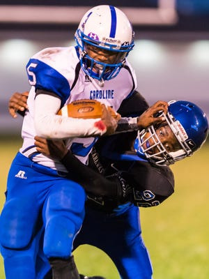 Stephen Decatur defensive back Avonte Purnell (22) attempts to wrap up North Caroline wide reciever Garret Rites (5) on Monday evening at Seahawk Stadium in Berlin.