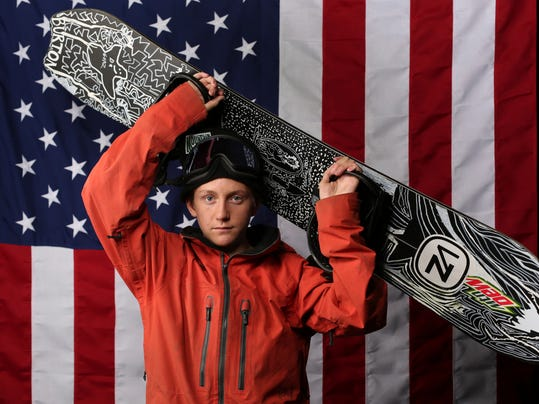 FILE - In this Sept. 27, 2017, file photo, U.S. Olympic Winter Games snowboarding big air hopeful Red Gerard poses for a portrait at the 2017 Team USA media summit, in Park City, Utah. If things go as planned, Gerard will walk away from the first Olympic Big Air contest with a gold medal around his neck. To hear the 17-year-old snowboarding phenom tell it, though, his greatest achievements don't lie ahead in South Korea. Instead, they've been scattered about his own backyard for years.  Gerard learned some of his best tricks in the features park he and his brothers set up on the hill on the back side of his house in Silverthorne, a few miles from the Continental Divide and the Breckenridge ski resort. (AP Photo/Rick Bowmer, File)