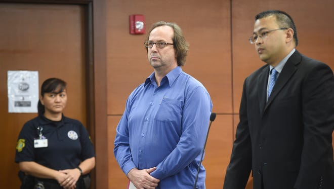 Michael Ehlert, University of Guam professor, center, appears in the Superior Court's Northern Satellite Court in Dededo for an arraignment on Jan. 20. Ehlert was indicted for criminal sexual conduct and official misconduct after an investigation into allegations he sexually assaulted students at an off-campus activity. Ehlert entered a plea of not guilty.