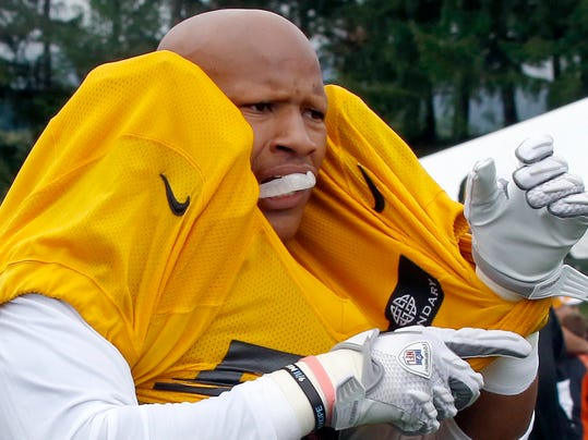 Pittsburgh Steelers outside linebacker Ryan Shazier (50) has to adjust his jersey and pads after completing a blocking drill during practice at NFL football training camp in Latrobe, Pa., on Monday, July 28, 2014 . (AP Photo/Keith Srakocic)