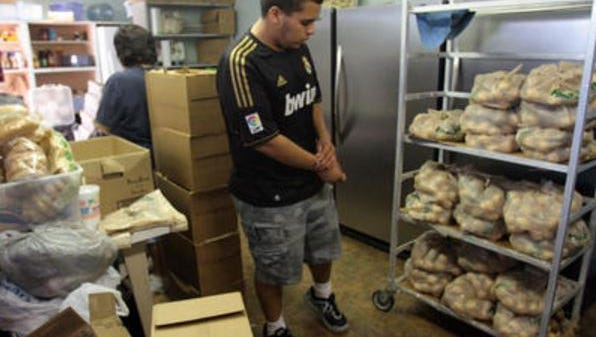 In this Desert Sun file photo, a volunteer packages sacks of potatoes at FISH Food Bank in Coachella on Thursday, July 25, 2013. The food bank has been dealing with a string of burglaries.