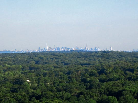 The New York City skyline is shown from the second viewpoint on Vista Loop Trail at the Ramapo Reservation.