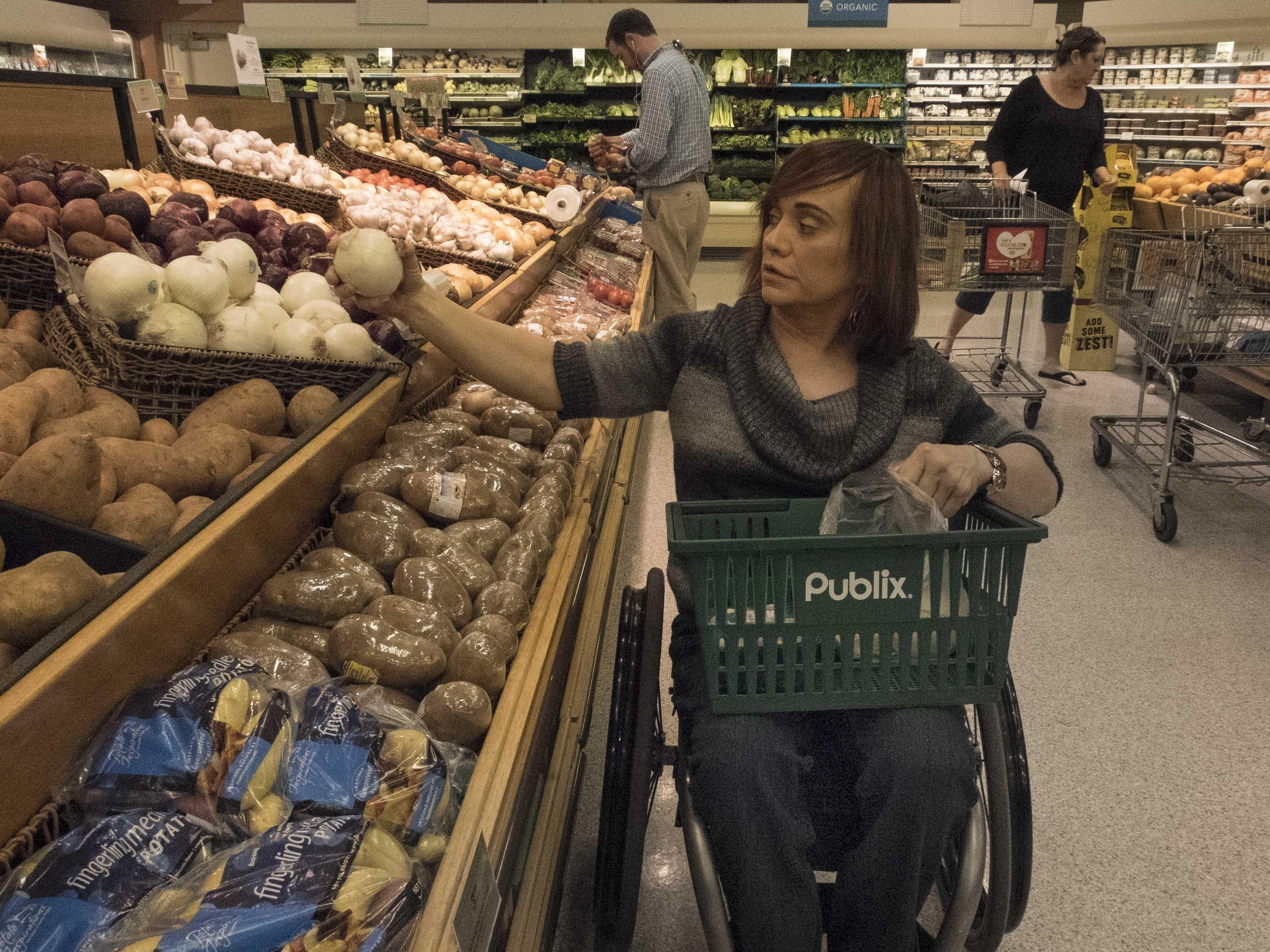 Robin Patty shops at a grocery store in her neighborhood