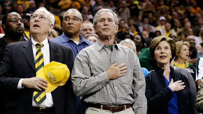 Ken Starr, former president George W. Bush and his wife, Laura, at a women's college basketball tournament last year in Waco, Texas.