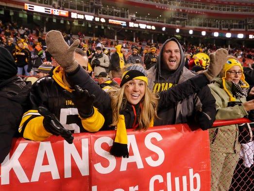 Iowa fans celebrate a win over Nebraska at Memorial