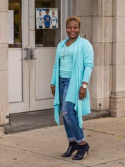 Angela Ringgold 7 for Mankind stretch distressed capri jeans; mint green T-shirt from Target; mint green asymmetrical duster from Dress Barn; navy blue suede and leather ankle boots by Nine West;