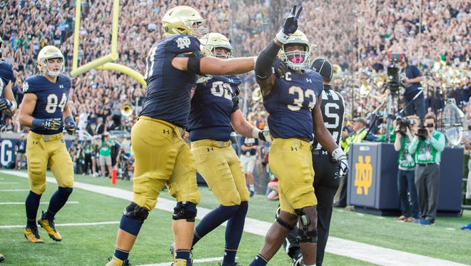 Sep 2, 2017; South Bend, IN, USA; Notre Dame Fighting Irish running back Josh Adams (33) celebrates after a touchdown in the fourth quarter against the Temple Owls at Notre Dame Stadium. Mandatory Credit: Matt Cashore-USA TODAY Sports