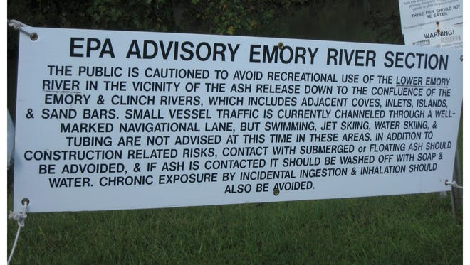 Signs warned the public of the danger of coal ash, but those safety precautions were not afforded workers, they say.