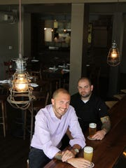 "Andrew Rasizer, general manager and partner, and Cesare ""Chez"" De Chellis, executive chef and partner, sit at the bar at B2 Bistro and Bar in Red Bank."