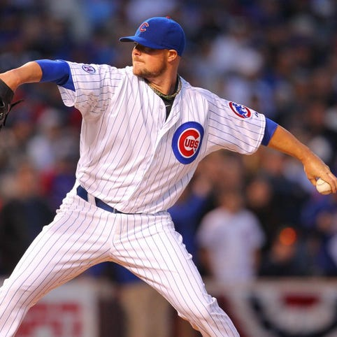 Apr 5, 2015; Chicago, IL, USA; Chicago Cubs starting pitcher Jon Lester (34) delivers a pitch during the first inning against the St. Louis Cardinals at Wrigley Field. Mandatory Credit: Dennis Wierzbicki-USA TODAY Sports