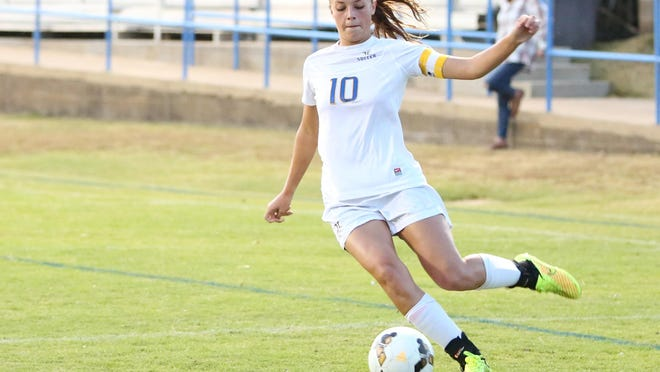 Jackson Christian's Amelia Grizzell sends a cross into the box against Madison in the Region 8 A-AA championship.