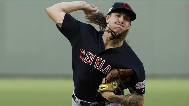 Indians starting pitcher Mike Clevinger throws during the first inning of a game last season in Kansas City, Mo.