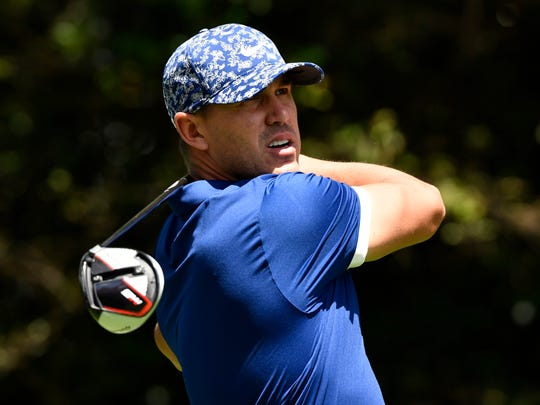 Brooks Koepka has a share of the lead with Bryson DeChambeau after the first round of the Masters.