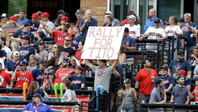 """A fan holds up a sign reading """"Rally for Tito"""" at Progressive Field in Cleveland."""