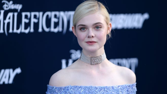 Elle Fanning arrives at the 'Maleficent' premiere Wednesday in Los Angeles.