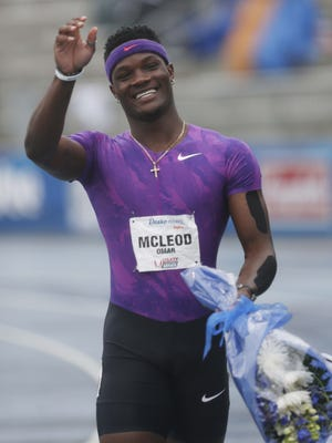 Runner Omar McLeod smiles after winning the 110 meter hurdles in the Rio Olympics Preview at the Drake Relays on Saturday, April 30, 2016, in Des Moines.