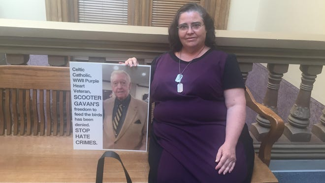 """Ila Solomon came to Friday's pre-trial conference outfitted with a handbag and poster featuring images of her late husband, 88-year-old Gerald """"Scooter"""" Gavan Jr. She disagrees with her attorney's motion for evaluation to determine whether she is competent to stand trial."""