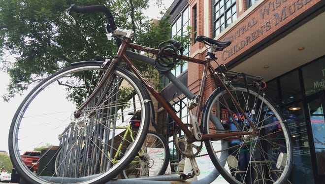 Bikes are locked to a rack in downtown Stevens Point on Tuesday. The city might install bike hitches downtown to offer a sturdier place for people to store their bicycles.