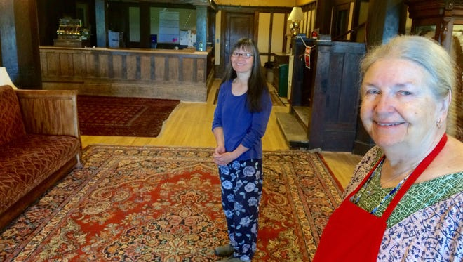 General manager Kerri Kumasaka, left and co-owner Anne Wilson Schaef stand in the refurbished lobby of the Peace Valley Hot Springs, also known as the Boulder Hot Springs Inn, Spa and Retreat Center.
