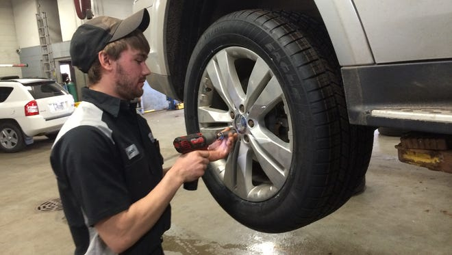 Tyson Krause works on a vehicle. Krause, 22, of Merrill, has worked at Olson Tire & Auto Service in Wausau for nearly four years as part of an internship program offerred by the Wisconsin Automotive Truck Education Association.