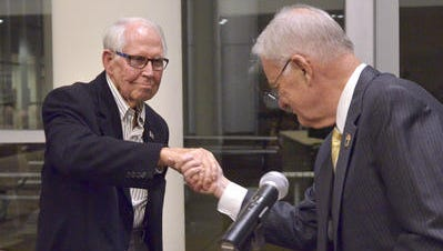 Joe Taylor, left, shakes hands with former Livonia mayor Jack Engebreston at the 1835 Livonia Hall of Fame ceremony in 2014 at Madonna University's Franciscan Center. The Livonia City Council chambers have recently been renamed in his honor.