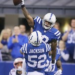 Indianapolis Colts strong safety Mike Adams celebrates an interception in the arms of teammate D'Qwell Jackson in the first half against the Patriots. Indianapolis hosted New England at Lucas Oil Stadium on Sunday, November 16, 2014.