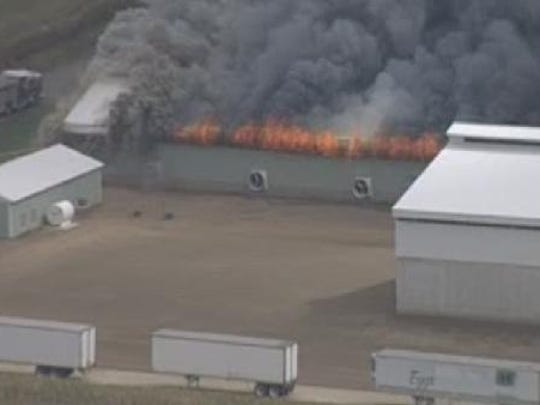 This photo taken by 10TV shows one of the large buildings at the egg farm full ablaze.