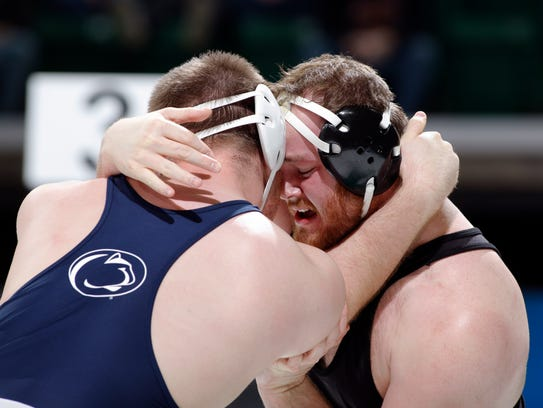 Iowa's Sam Stoll, right, and Penn State's Nick Nevills