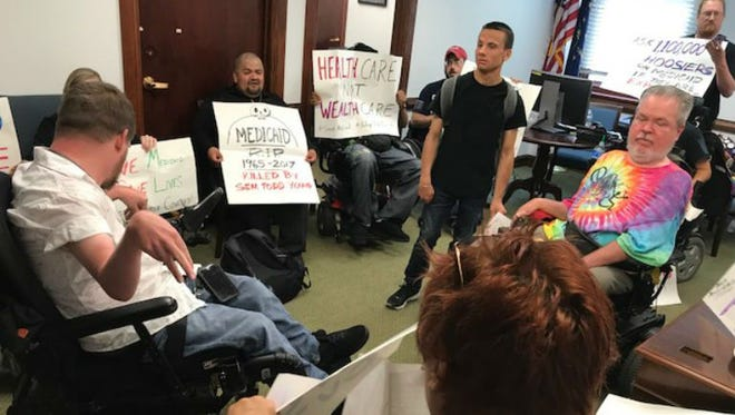 Demonstrators sit-in Sen. Todd Young's Indianapolis office.