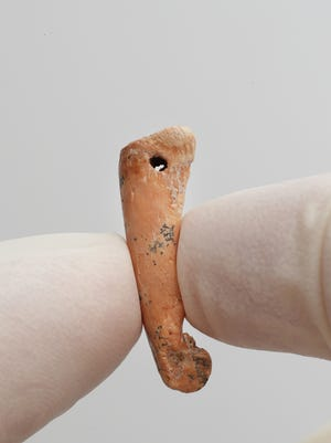 This finger bone from a native animal was worn as a pendant or similar piece of jewelry more than 20,000 years ago. Wear marks on the ornament show that it repeatedly rubbed against human skin or clothing while in use.