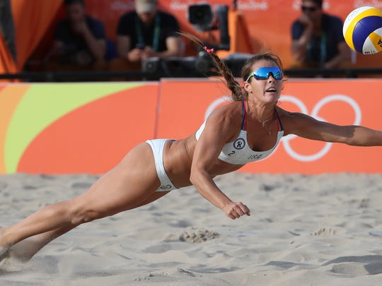 Aug 11, 2016; Rio de Janeiro, Brazil; United States right defender Brooke Sweat (2) dives for a ball in a women's preliminary - Pool A match against Russia at the Beach Volleyball Arena during the Rio 2016 Summer Olympic Games. Mandatory Credit: Keven Jairaj-USA TODAY Sports