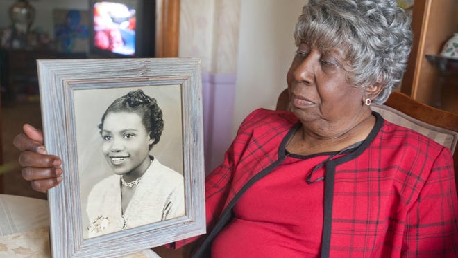 Flora Shanklin, sister of the late Alberta Jones, Louisville's first black woman prosecutor who was murdered 51 years ago this week in 1965, holds a portrait Jones. The photo, a birthday present for their mother, was taken ten years prior to Jones' death. A Bellarmine professor writing a book about Jones is asking Louisville police chief Steve Conrad to reopen the investigation into her unsolved death. 01 August 2016