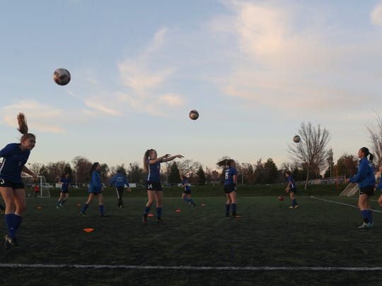 U-Prep's girls varsity soccer team members warm up before their game against West Valley Tuesday at the California Soccer Park in Redding. The team is 20-2 and is the No. 1 seed going into the playoffs.