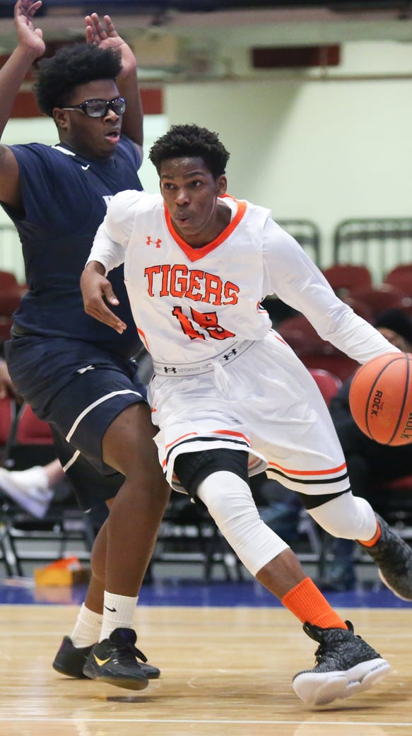 Spring Valley's Mavenson Therneus (15)  drives the