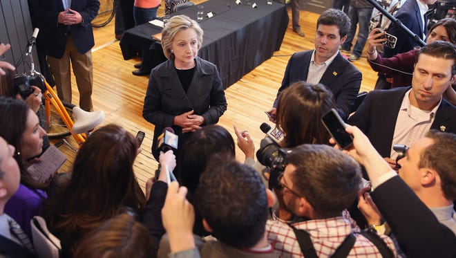 Hillary Clinton takes questions from the press after hosting a small business forum in Cedar Falls, Iowa, on Tuesday.