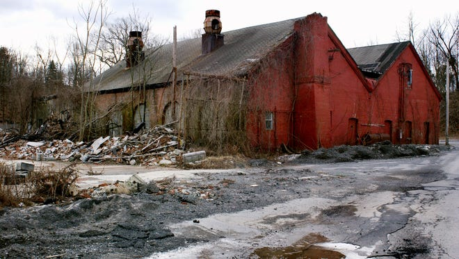 In this 2006 file photo, two buildings still stand on the Three Star Anodizing Hazardous Waste Site in Wappingers Falls. A 2004 fire led to the demolition of other buildings on the site, complicating the investigation and cleanup of pollution there.