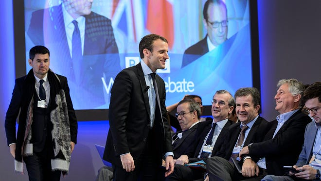 French Economy Minister Emmanuel Macron (second left), arrives during a panel session at the 46th Annual Meeting of the World Economic Forum, WEF, in Davos, Switzerland, 22 Jan. 2016.