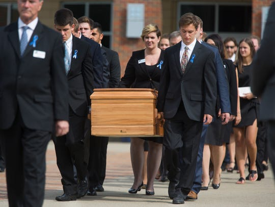 Pallbearers carry the casket of Otto Warmbier to the waiting hearse at Wyoming High School following his funeral. Warmbier, 22, died last year, less then a week after being returned from North Korea in a coma, where he had been imprisoned for more than a year. The University of Virginia student had been in North Korea as part of a tour group. Warmbier was a 2013 graduate of Wyoming.